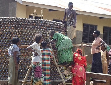 Trainees_learning_to_construct_a_10000_ltrs_rain_water_harvesting_tank_out_of_waste_plastic_bottles_as_bricks.jpg